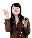 Woman listening to music with the phone and having fun. Isolated on white background Royalty Free Stock Photo