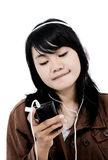 Woman listening to music with the phone and having fun Stock Photo