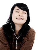 Woman listening to music with the phone and having fun Stock Photography