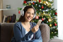 Woman listening to music posing on chritmas at home royalty free stock photography