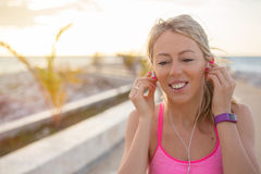 Woman listening to music while running in early morning Stock Photography