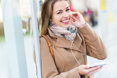Woman listening to music with smartphone Royalty Free Stock Photo