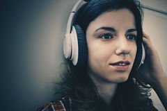 Woman listening to music. With a smile stock photography