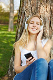 Woman listening to music streaming Royalty Free Stock Photography