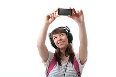 Woman listening to music and taking pictures themselves Stock Photo