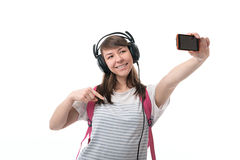 Woman listening to music and taking pictures themselves Royalty Free Stock Image