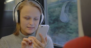 Woman Listening to Music and Writing Messages stock video footage