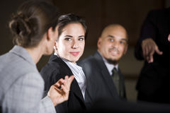 Woman listening to office colleague in meeting. Woman listening to office colleague during presentation Royalty Free Stock Photography