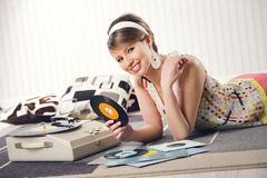 A woman listening to a record Royalty Free Stock Photography