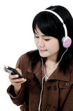 Woman listening to sad music with the phone Royalty Free Stock Photos