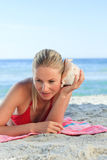 Woman listening to a shell Royalty Free Stock Photos