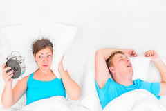 Woman listening to the snoring husband Royalty Free Stock Photos
