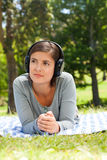 Woman listening to some music. In the park Stock Images