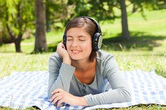 Woman listening to some music. In the park Stock Photo