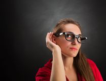 Woman is listening to Royalty Free Stock Image