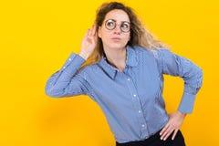 Woman listening to something Stock Image