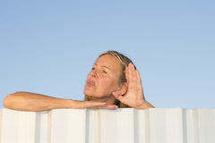 Woman listening to sound outdoor Royalty Free Stock Photography