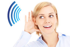 Woman listening Stock Images