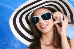 Woman listens seashell Royalty Free Stock Images