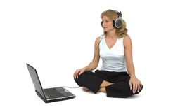 A woman listens to music. A woman listens to music on the laptop Stock Photos
