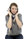 Woman listens to music Royalty Free Stock Images