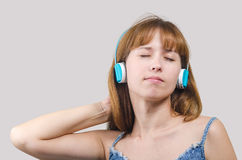 The woman listens to music in earphones Royalty Free Stock Photography