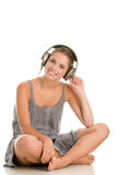 Woman listetning to music Stock Photos