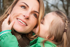 Woman listnening her daugther with smile Stock Image