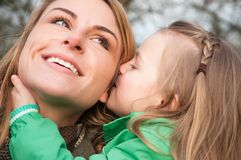 Woman listnening her daugther with smile Stock Photos