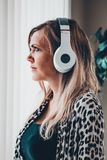 Woman listning with wireless headphones stock photos