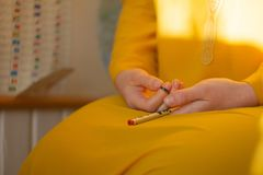 Woman, lit hand, counts Malas, strands of gemstones beads royalty free stock images