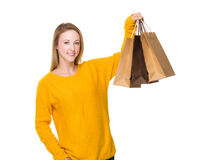 Woman with lits of shopping bag Royalty Free Stock Image