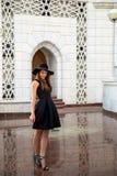 Woman in little black dress