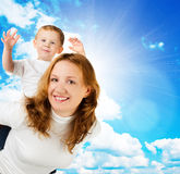 Woman and little boy  against blue sky Stock Image