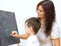 Woman and little boy drawing Royalty Free Stock Photography