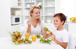 Woman and little boy having a healthy snack Royalty Free Stock Photo