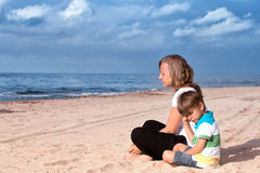 Woman and little boy Stock Images