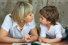 Woman and little boy reading book Stock Photo