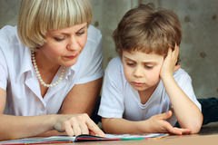 Woman and little boy reading book Royalty Free Stock Photo