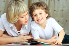 Woman and little boy reading book Royalty Free Stock Image
