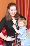 Woman and little child Stock Photos