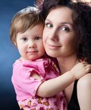 Woman and little daughter Royalty Free Stock Photo
