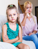 Woman and little daughter having quarrel Royalty Free Stock Photos