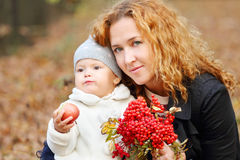 Woman with little daughter and rowanberry Stock Image