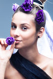 Woman with little flower in mouth Royalty Free Stock Photography