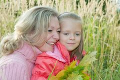 Woman with  little girl in autumn Royalty Free Stock Photos