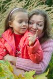 Woman with  little girl in autumn Royalty Free Stock Photo