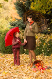 Woman and little girl in autumn park with apple basket Royalty Free Stock Photos