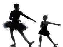 Woman and little girl  ballerina ballet dancer dancing silhouett Stock Image