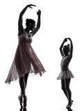 Woman and little girl  ballerina ballet dancer dancing silhouett. Woman and  little girl   ballerina ballet dancer dancing in silhouette on white background Royalty Free Stock Photo